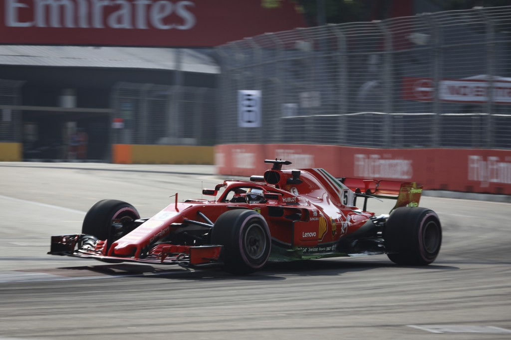Ferrari driver Sebastian Vettel of Germany steers his car during first practice at the Marina Bay City Circuit ahead of the Singapore Formula One Gran...