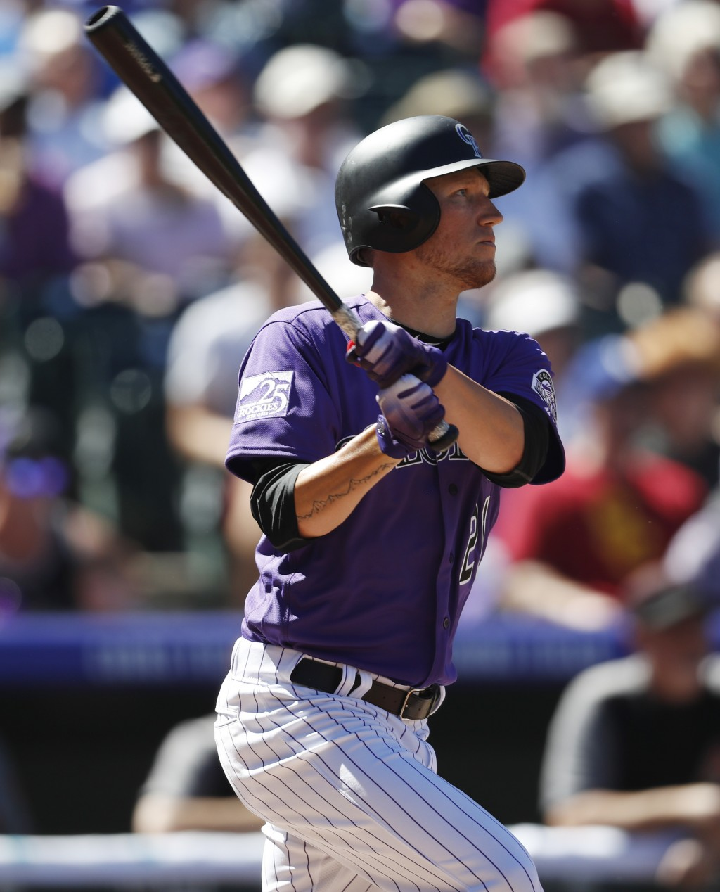 Colorado Rockies' Kyle Freeland follows the flight of his RBI-double off Arizona Diamondbacks starting pitcher Matt Koch in the second inning of a bas
