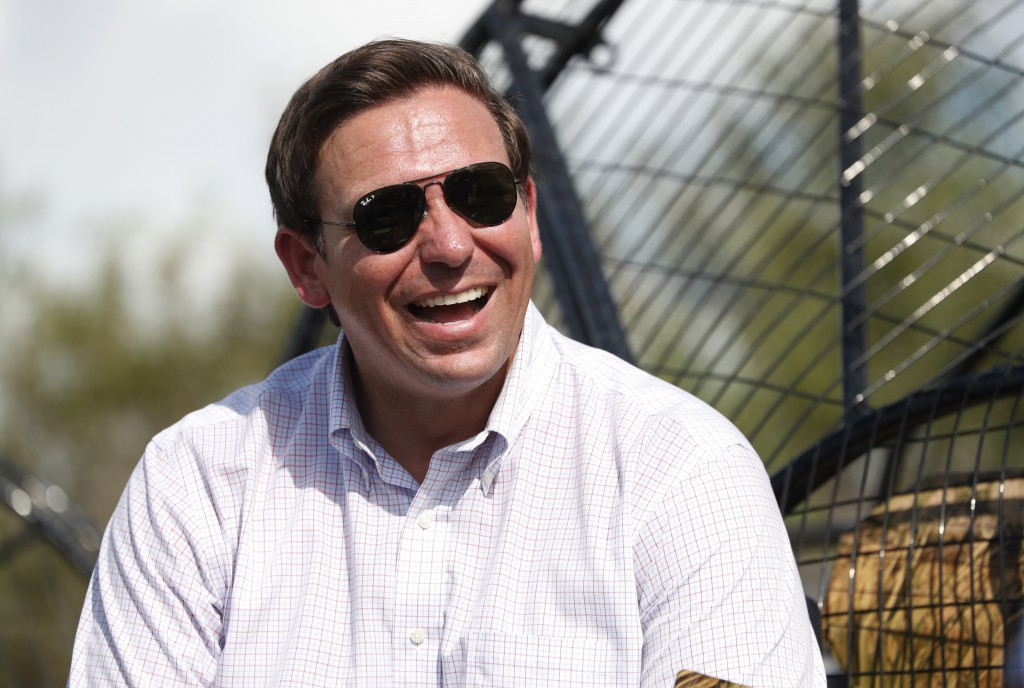 FILE - In this Sept. 12, 2018, file photo, Republican candidate for Florida Governor Ron DeSantis smiles during an airboat tour of the Florida Evergla