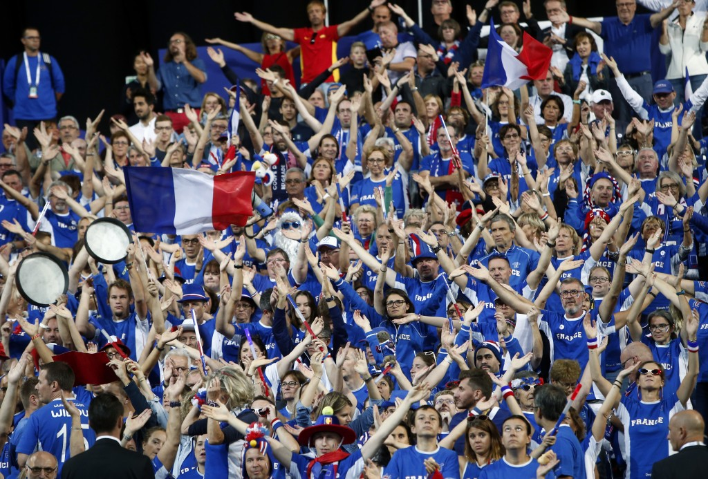 Supporters of the French tennis team wave before the Davis Cup France against Spain, Friday, Sept.14, 2018 in Lille, northern France. (AP Photo/Michel