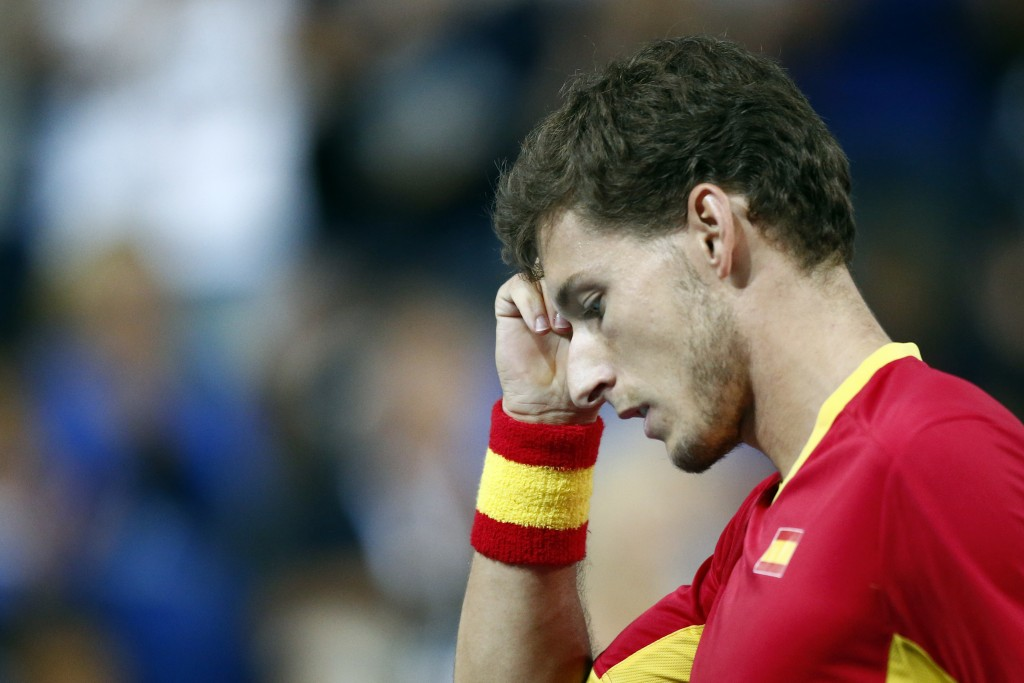 Spain's Pablo Carreno Busta reacts as he plays France's Benoit Paire during the Davis Cup semifinals France against Spain, Friday, Sept.14, 2018 in Li