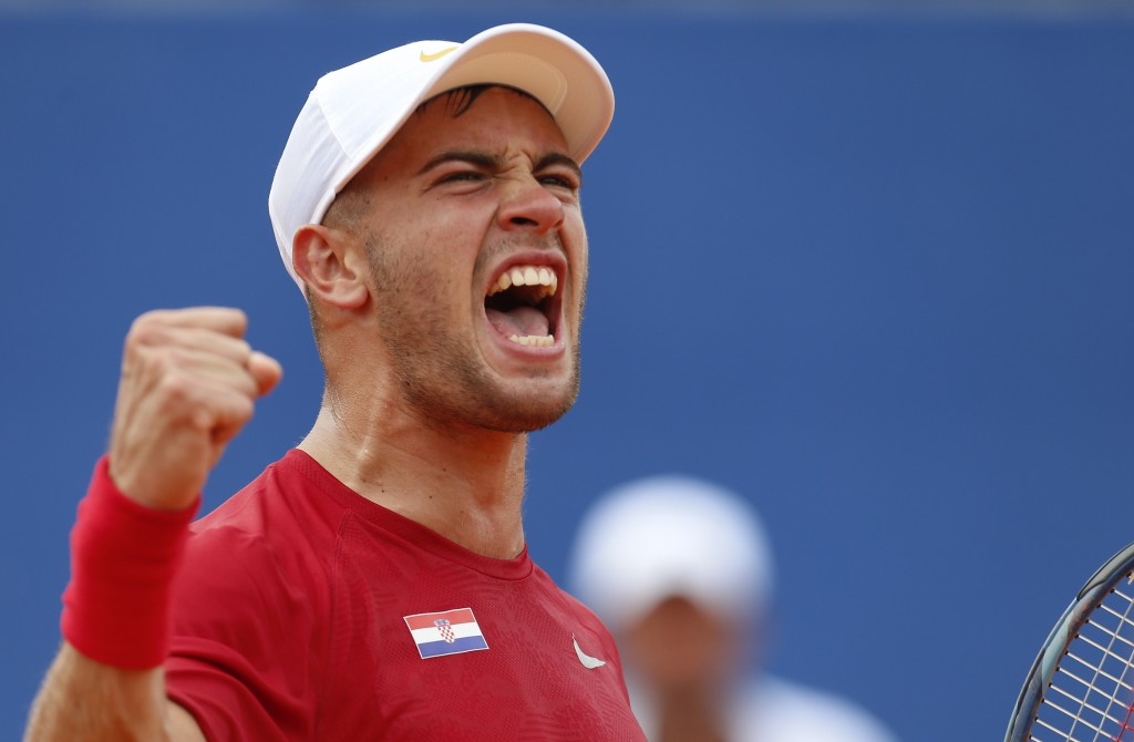 Borna Coric of Croatia celebrates after winning the second set as he plays against Steve Johnson of the United States during a Davis Cup semifinal sin