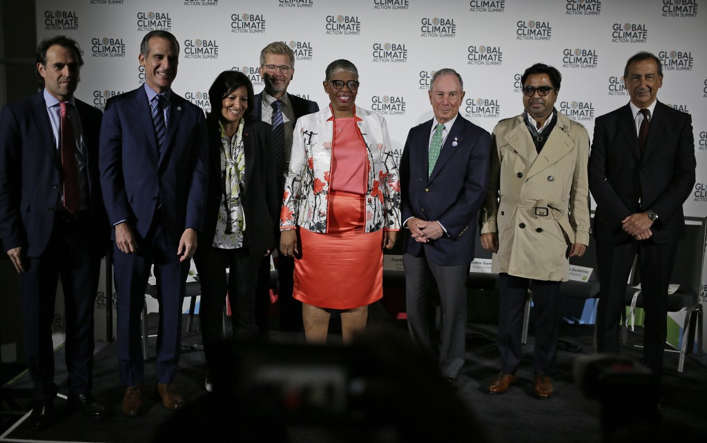 A group of world mayors pose with Michael Bloomberg, third from right, at a news conference during the Global Action Climate Summit Thursday, Sept. 13