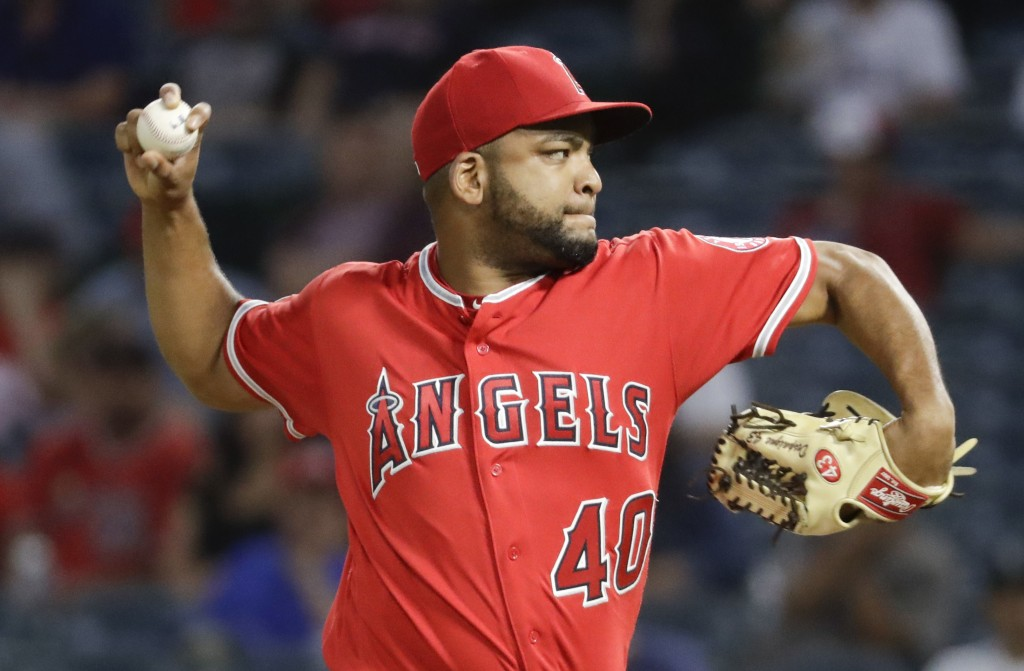 Los Angeles Angels starting pitcher Odrisamer Despaigne throws against the Seattle Mariners during the first inning of a baseball game in Anaheim, Cal