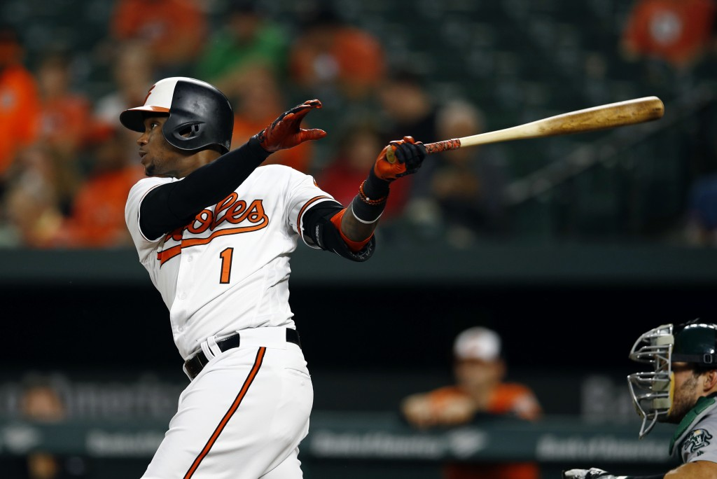 Baltimore Orioles' Tim Beckham singles in the first inning of a baseball game against the Oakland Athletics, Thursday, Sept. 13, 2018, in Baltimore. C