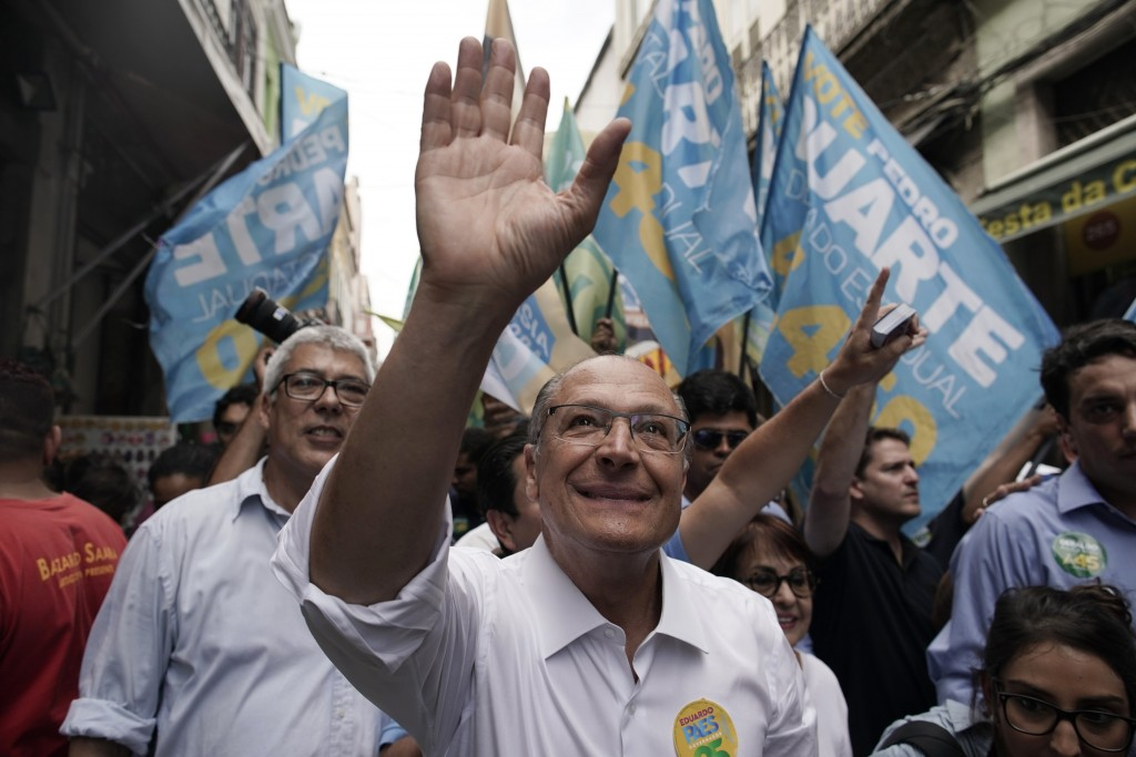 Geraldo Alckmin, presidential candidate with the Social Democratic Party, greets supporters as he campaigns in downtown Rio de Janeiro, Brazil, Thursd