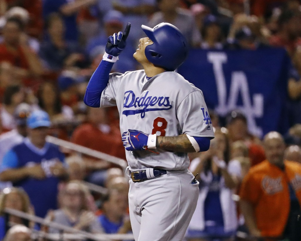 Los Angeles Dodgers' Manny Machado points skyward after hitting a home run off of St. Louis Cardinals relief pitcher John Brebbia during the seventh i