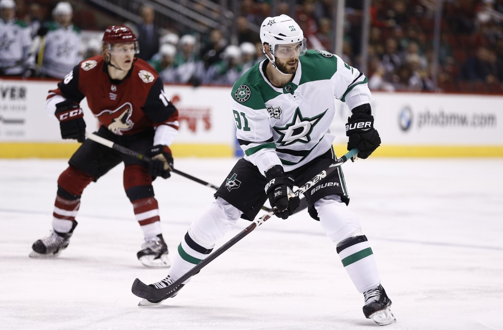 FILE - In this Feb. 1, 2018, file photo, Dallas Stars center Tyler Seguin (91) skates during the first period of an NHL hockey game Arizona Coyotes in