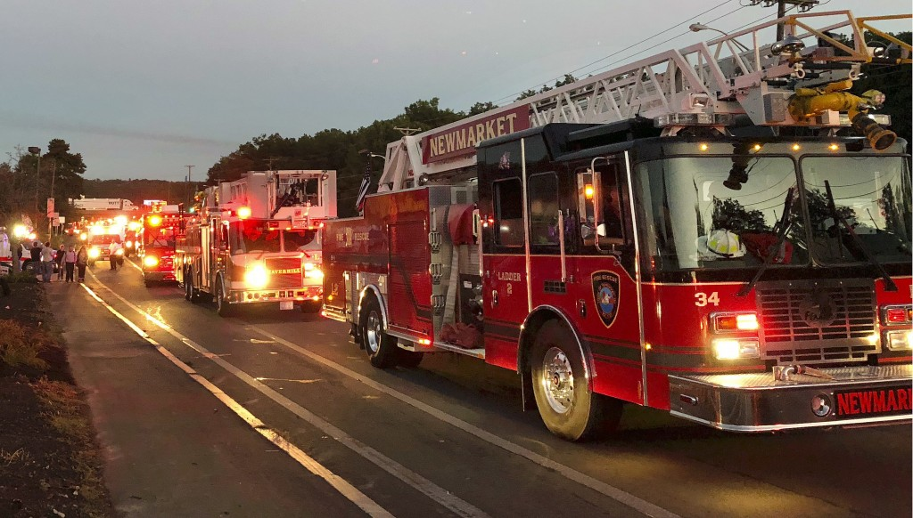 Multiple fire trucks from surrounding communities arrive Thursday, Sept. 13, 2018, in Lawrence, Mass., responding to a series of gas explosions and fi