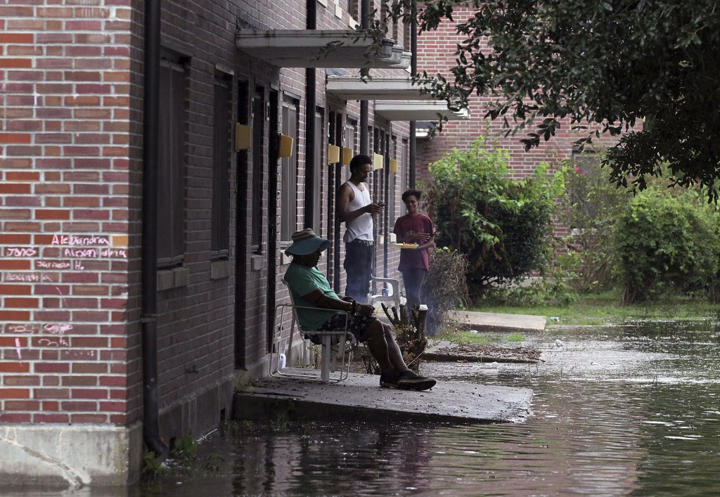 Residents at Trent Court Apartments wait out the weather as rising waters get closer to their doors in New Bern, N.C. Thursday, Sept. 13, 2018. Hurric