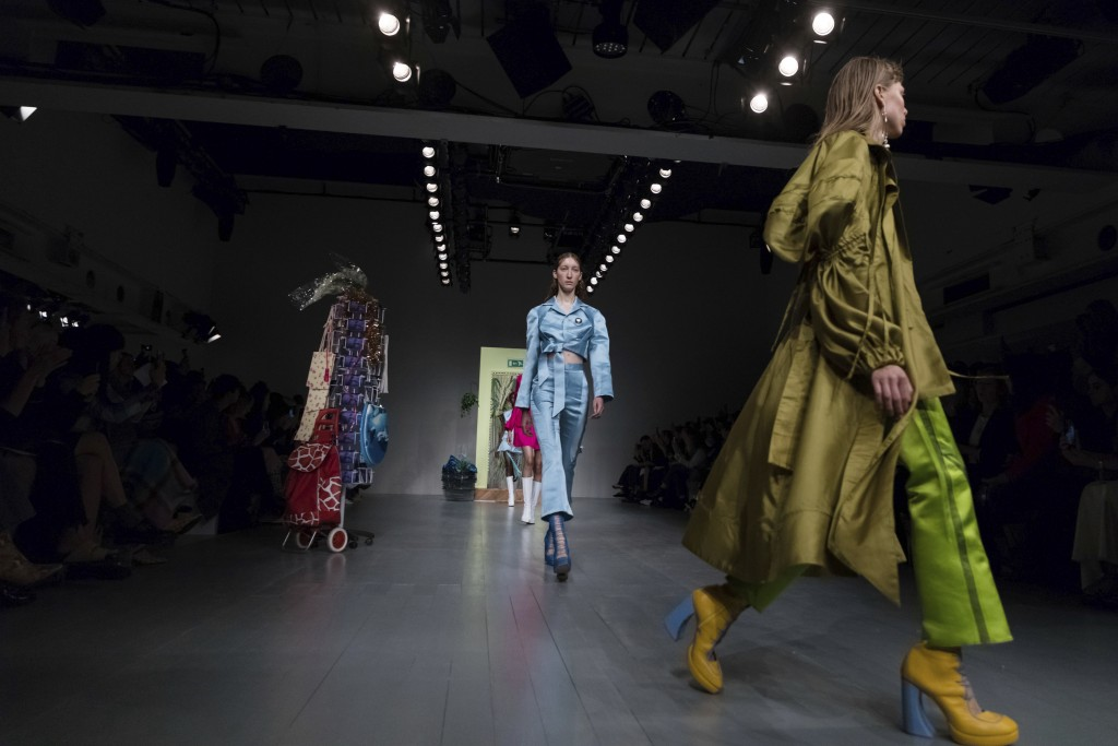 Models wear creations by designer Richard Malone during the Spring/Summer 2019 runway show at London Fashion Week in London, Friday, Sept. 14, 2018. (
