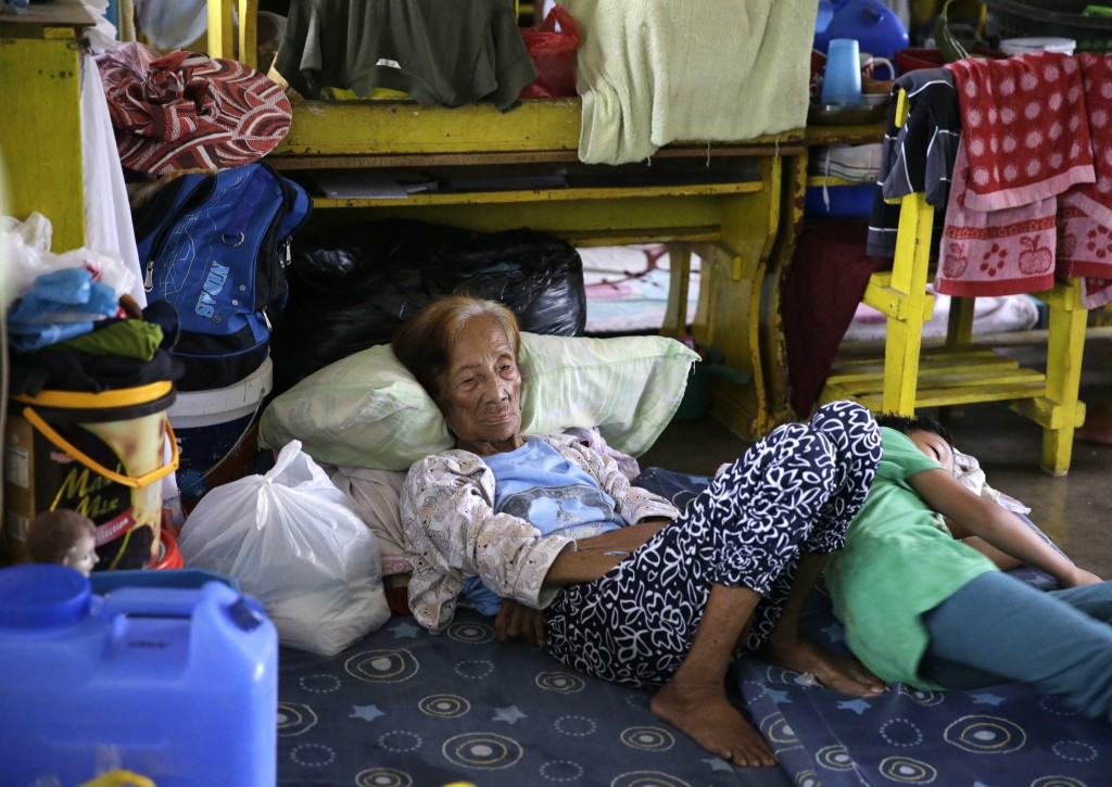 An evacuee rests inside an evacuation center as rains from Typhoon Mangkhut begin to affect Tuguegarao city, Cagayan province, northeastern Philippine