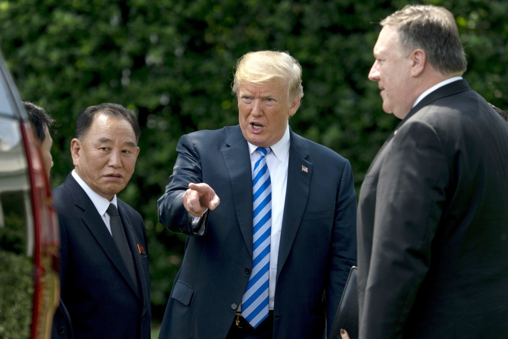 FILE - In this June 1, 2018, file photo, President Donald Trump, center, talks with Kim Yong Chol, left, former North Korean military intelligence chi