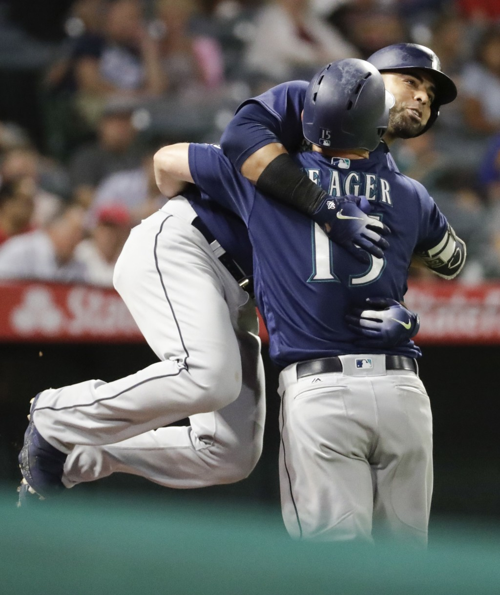 Seattle Mariners' Nelson Cruz, left, celebrates after his three-run home run with Mitch Haniger during the fourth inning of a baseball game against th