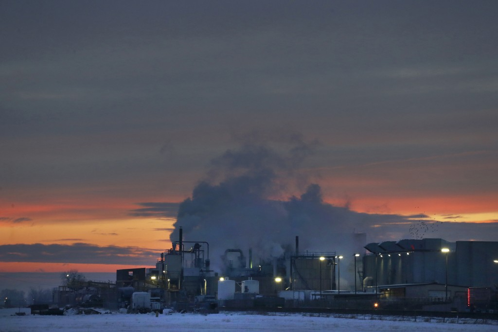 FILE - In this Jan. 11, 2016 file photo, dawn approaches over the meat processing plant owned and run by Cargill Meat Solutions, in Fort Morgan, a sma
