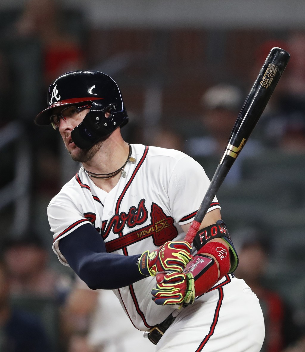 Atlanta Braves' Tyler Flowers (25) follows through on a two-run base hit in the third inning of a baseball game against the Washington Nationals Frida