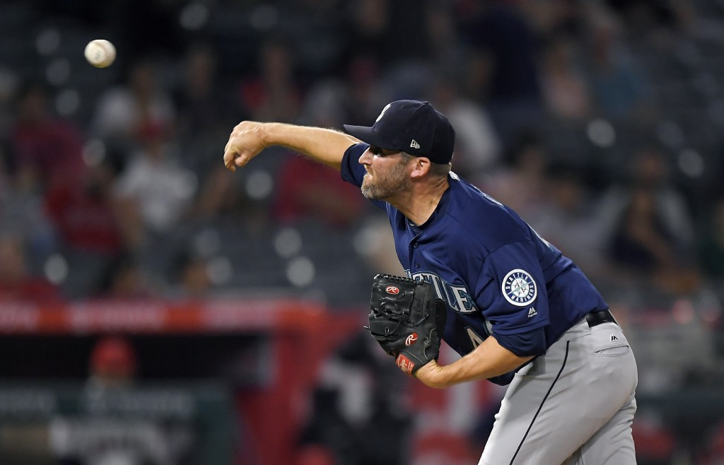 Seattle Mariners relief pitcher Ryan Cook throws to the plate during the ninth inning of a baseball game against the Los Angeles Angels Friday, Sept.