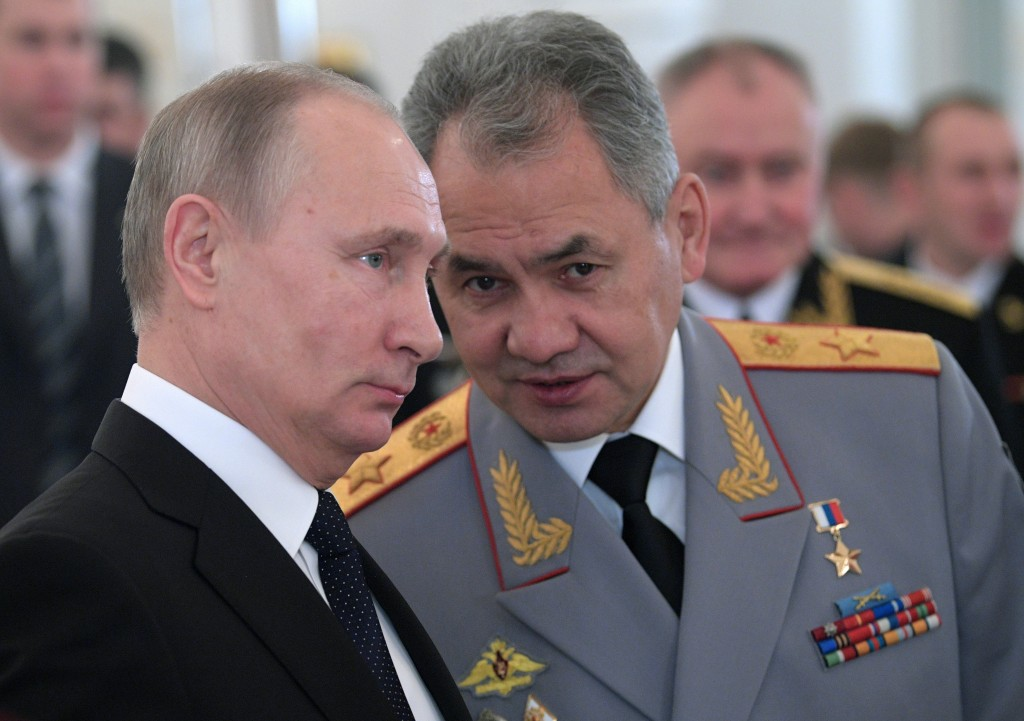 FILE In this file photo taken on Thursday, Dec. 28, 2017, Russian President Vladimir Putin, left, and Defence Minister Sergei Shoigu talk during an aw