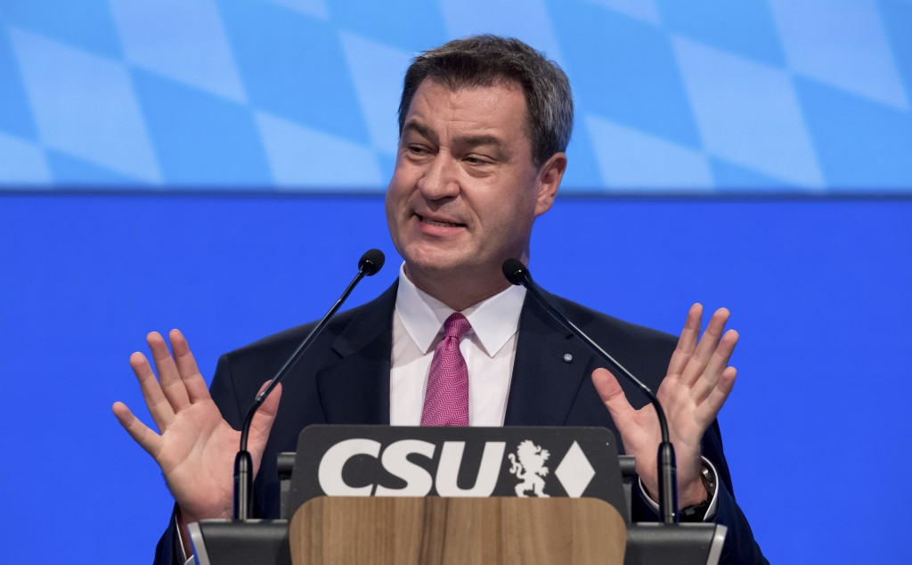 Bavarian State Governor Markus Soeder delivers a speech at a party convention of his German Christian Social Union in Munich, Germany, Saturday, Sept.