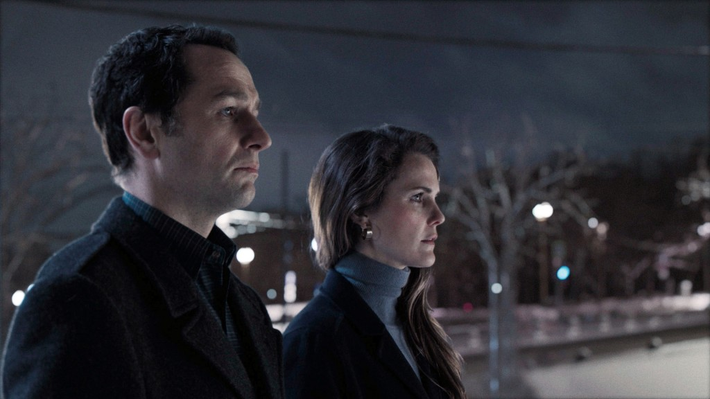 "This image released by FX shows Matthew Rhys, left, and Keri Russell in a scene from ""The Americans."" The program iss nominated for an Emmy on Thursda..."