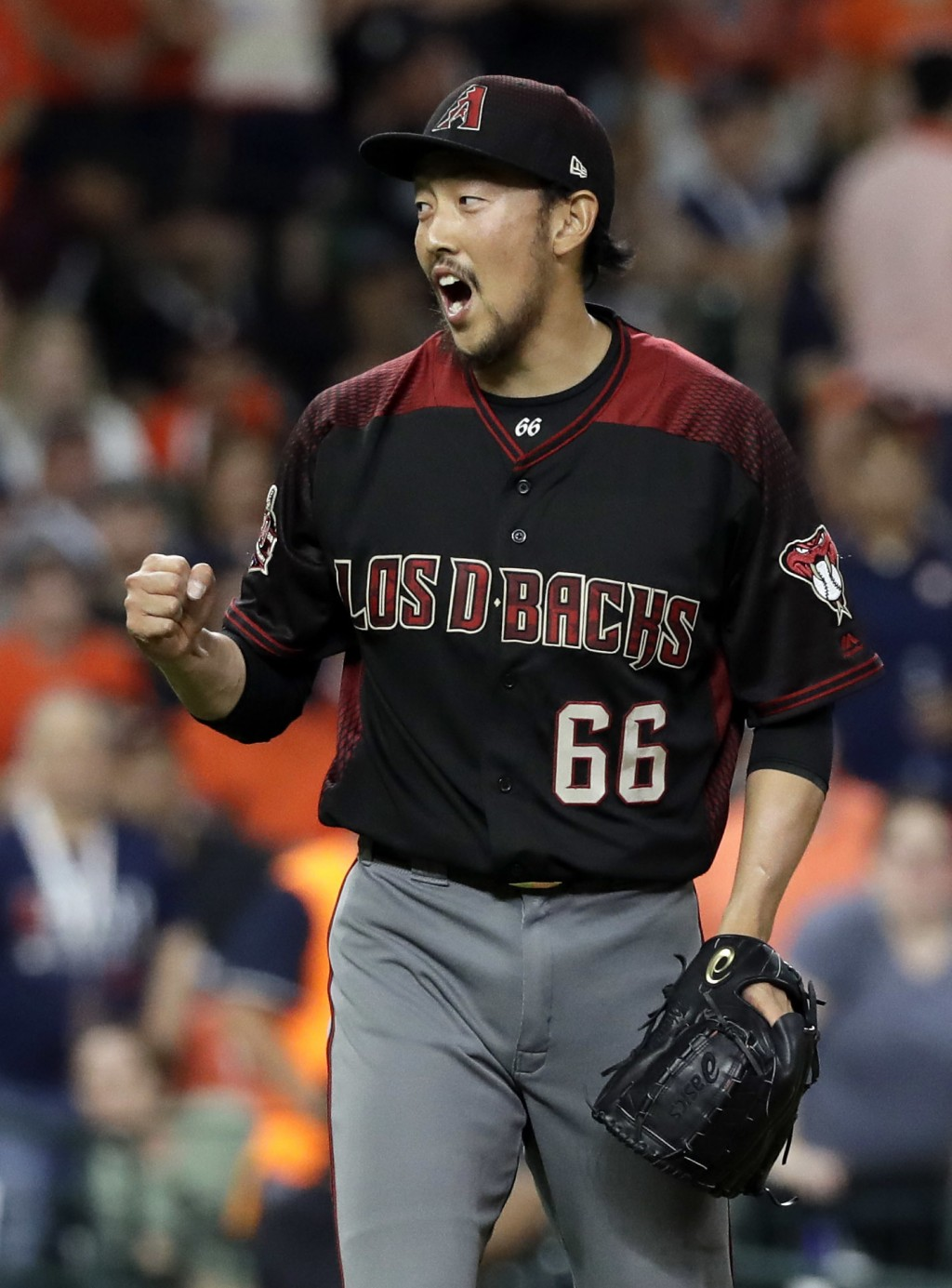 Arizona Diamondbacks relief pitcher Yoshihisa Hirano (66) reacts after the final out in the ninth inning of a baseball game against the Houston Astros