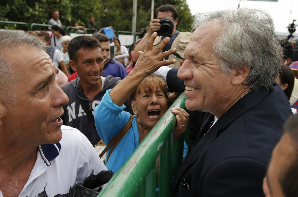 Organization of American States Secretary-General Luis Almagro talks with Venezuelan migrants in La Parada, border with Venezuela, Colombia, Friday, S