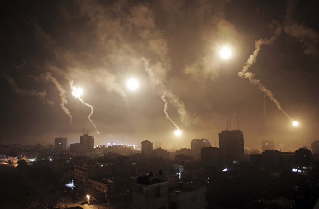 FILE - In this July 29, 2014 file photo, Israeli forces' flares light up the night sky of Gaza City. (AP Photo/Khalil Hamra, File)