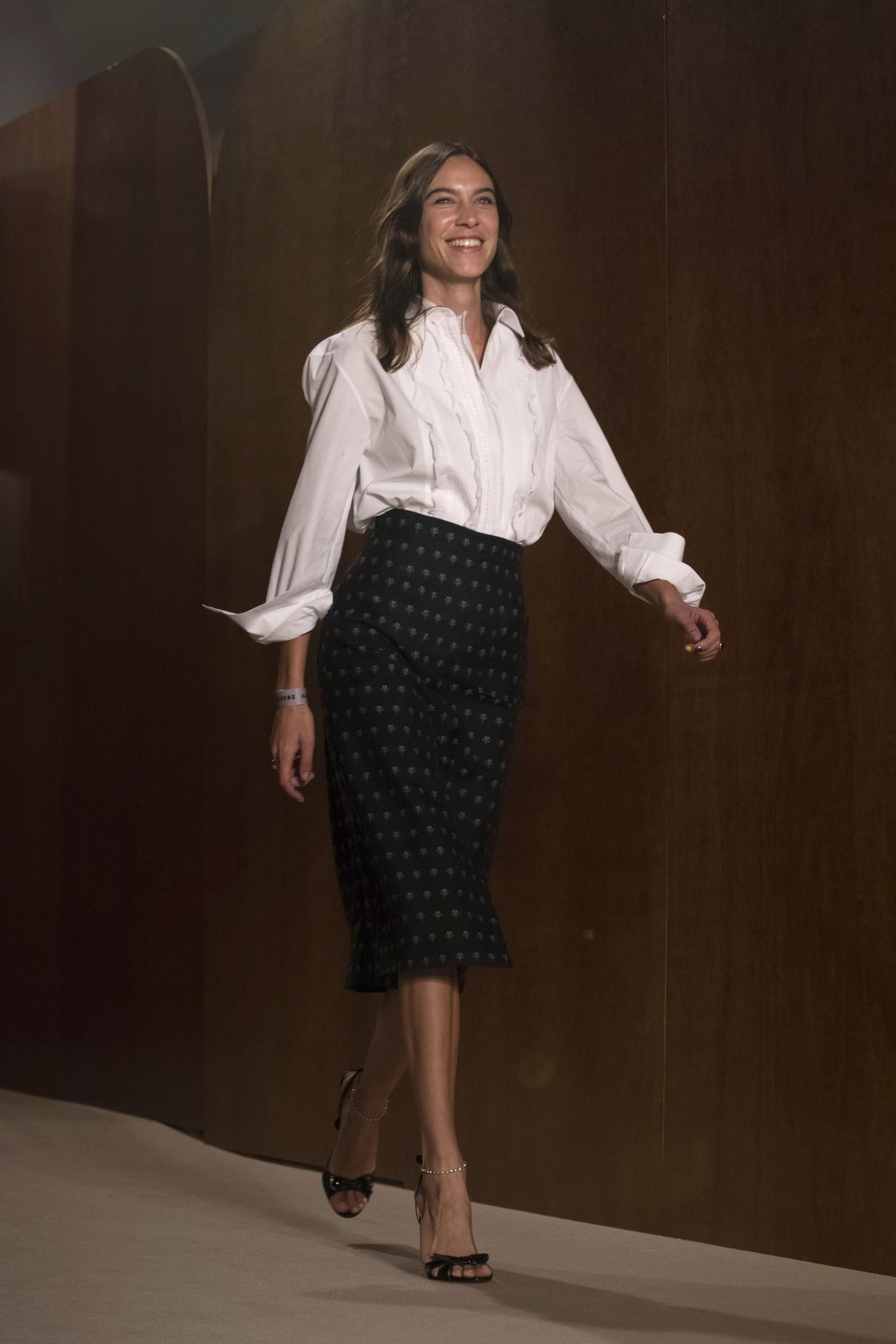 Designer Alexa Chung acknowledges applause following her Spring/Summer 2019 runway show at London Fashion Week in London, Friday, Sept. 15, 2018. (Pho