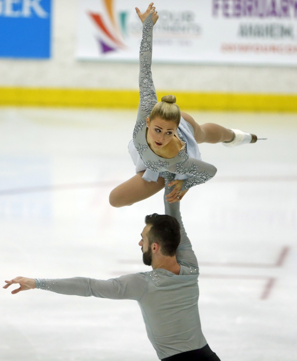 Ashley Cain and Timothy Leduc, of the United States, perform during the pairs free skate at the U.S. International Figure Skating Classic, Friday, Sep