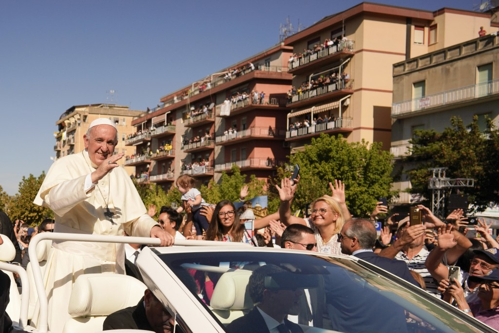 Pope Francis waves as he leaves at the end of his visit to Piazza Armerina, Italy, Saturday, Sept. 15, 2018. Pope Francis is paying tribute in Sicily