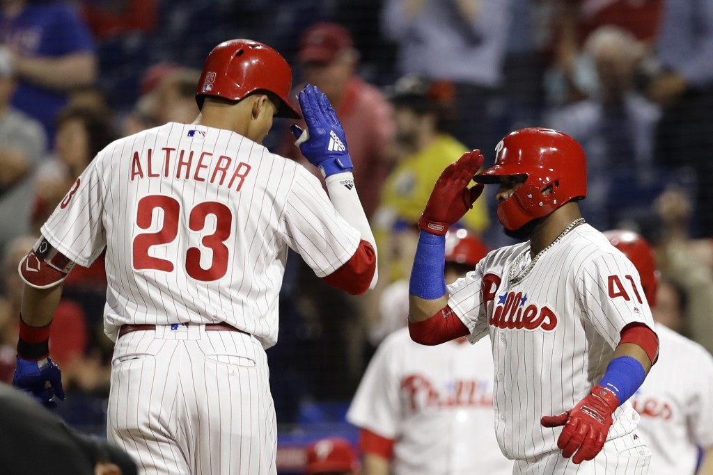 Philadelphia Phillies' Aaron Altherr, left, and Carlos Santana celebrate after Altherr's two-run home off Miami Marlins starting pitcher Wei-Yin Chen ...
