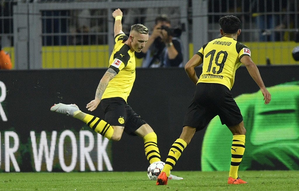 Dortmund's Marius Wolf scores his side's second goal during the German Bundesliga soccer match between Borussia Dortmund and Eintracht Frankfurt in Do