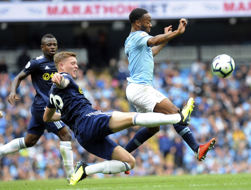 Manchester City's Raheem Sterling, right, and Fulham's Alfie Mawson battle for the ball during the English Premier League soccer match between Manches