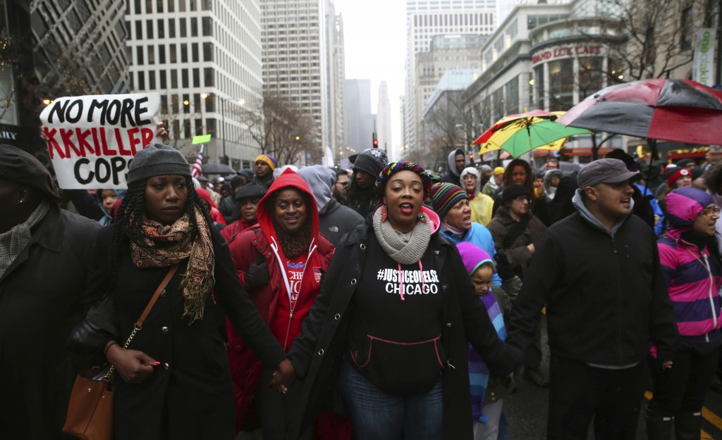 "FILE - In this Friday, Nov. 27, 2015 file photo, people gather during a ""march for justice"" demonstration in Chicago in the wake of the release of a p"
