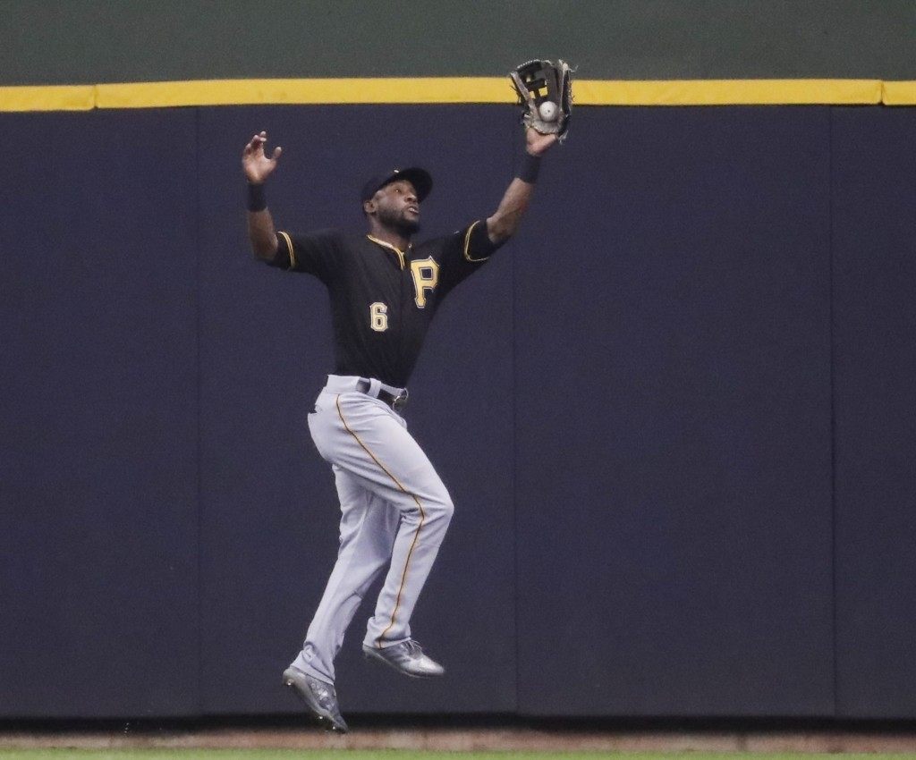 Pittsburgh Pirates' Starling Marte makes a running catch on a ball hit by Milwaukee Brewers' Ryan Braun during the fourth inning of a baseball game Fr