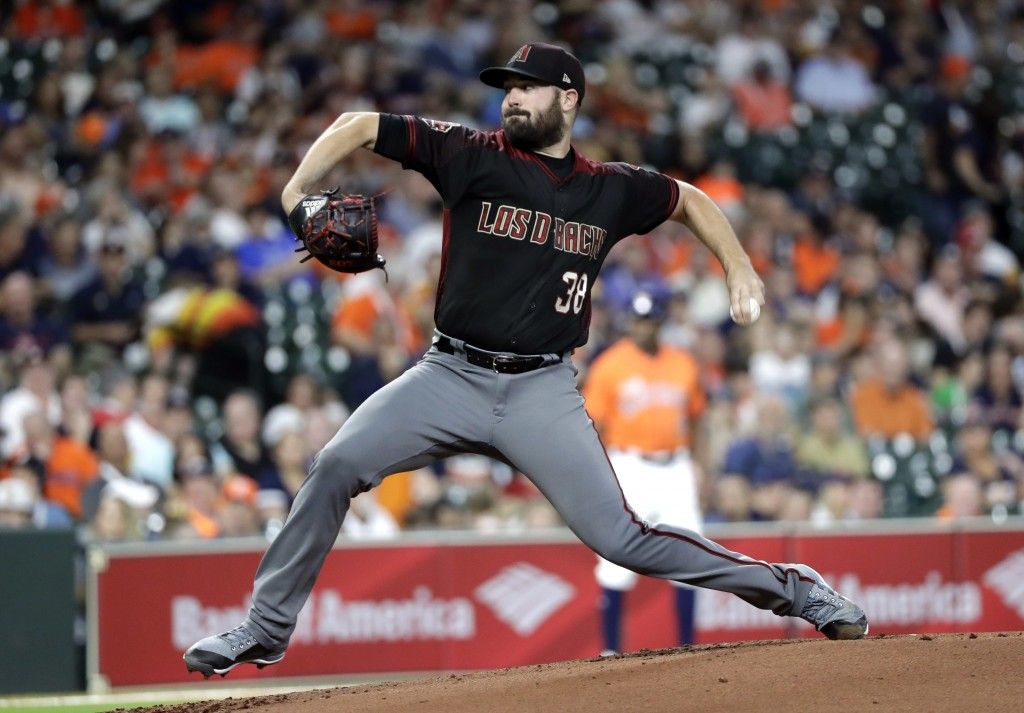 Arizona Diamondbacks starting pitcher Robbie Ray throws against the Houston Astros during the first inning of a baseball game Friday, Sept. 14, 2018, ...