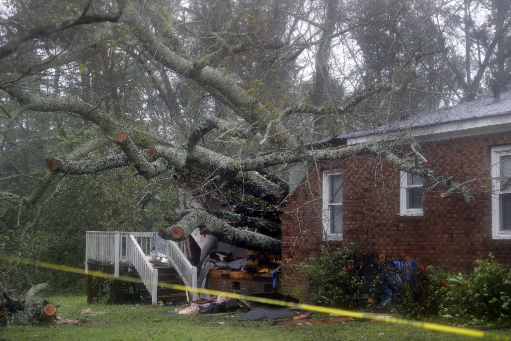 A fallen tree is shown after it crashed through the home where a woman and her baby were killed in Wilmington, N.C., after Hurricane Florence made lan