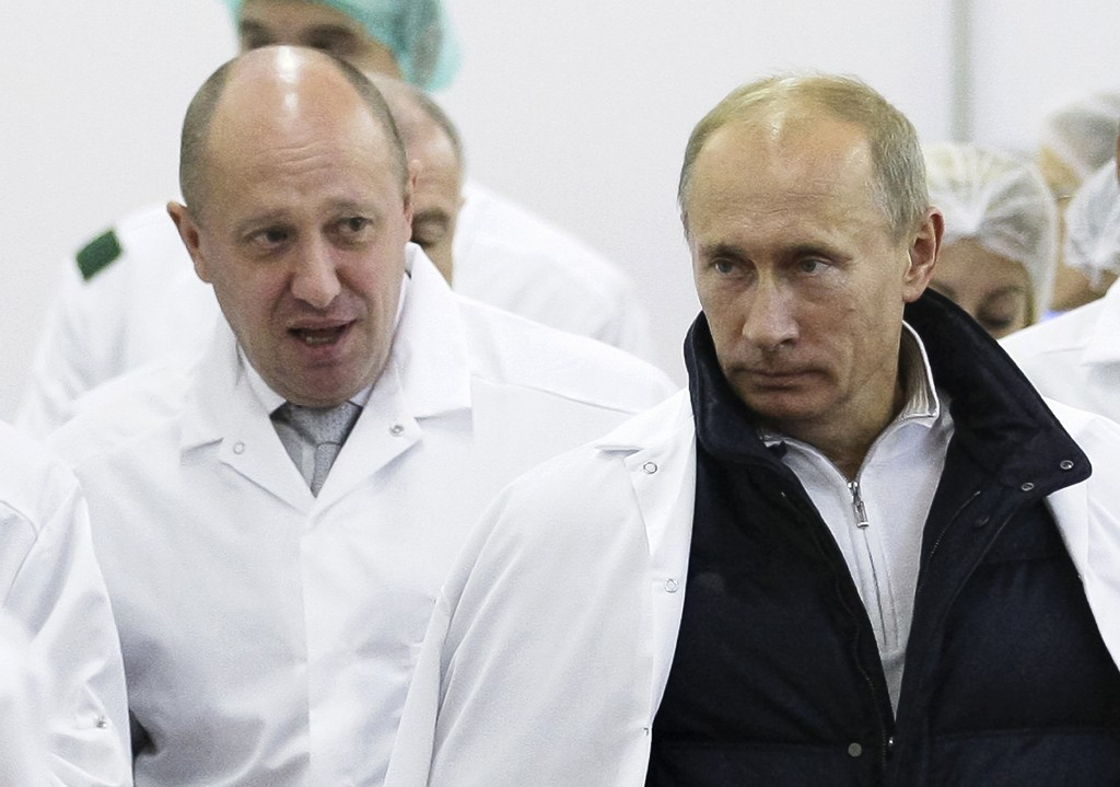 FILE - In this Monday, Sept. 20, 2010 file photo, businessman Yevgeny Prigozhin, left, shows Russian President Vladimir Putin, around his factory whic