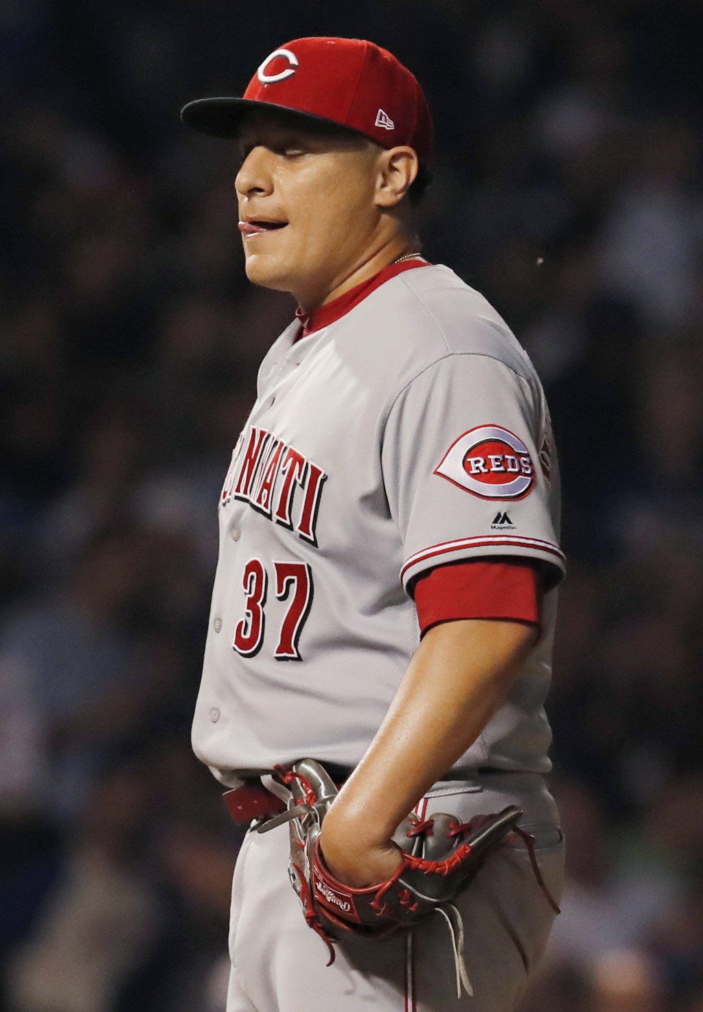 Cincinnati Reds' David Hernandez reacts after giving up a a three-run home run to Chicago Cubs' Ian Happ during the seventh inning of a baseball game