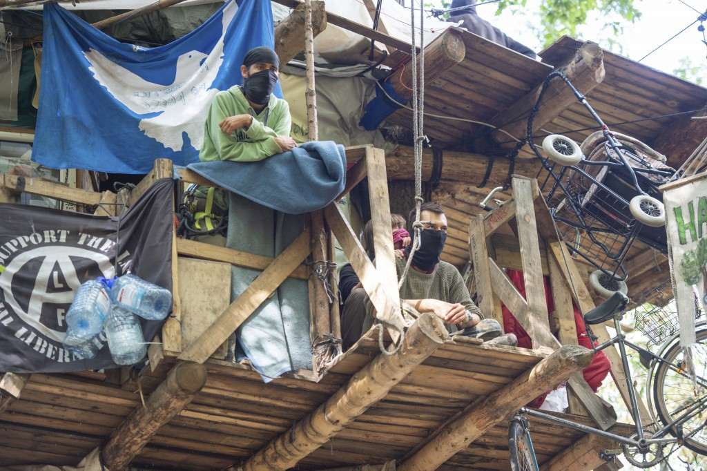 Protesters are seen in their tree house in the Hambach forest in Kerpen, Germany, Saturday, Sept. 15, 2018. German energy company RWE plans clearing a