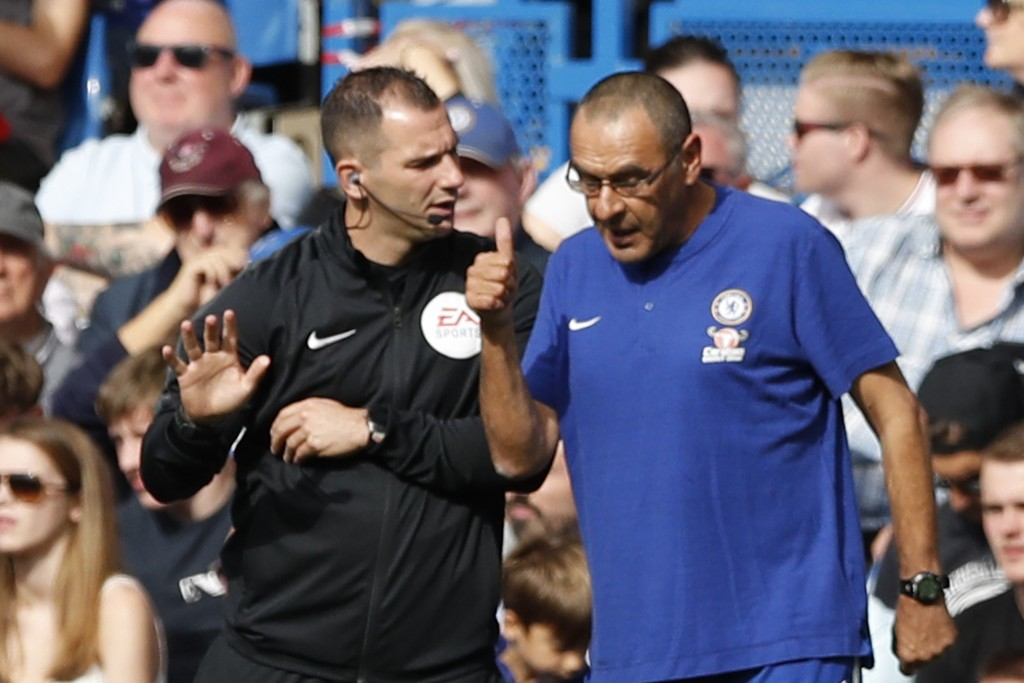 Chelsea's manager Maurizio Sarri talks to the fourth official during their English Premier League soccer match between Chelsea and Cardiff City at Sta