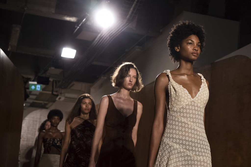 Models wear creations by designer Alexa Chung during their Spring/Summer 2019 runway show at London Fashion Week in London, Friday, Sept. 15, 2018. (P