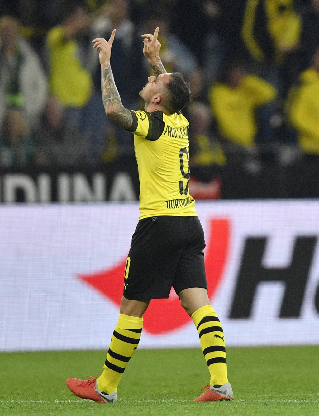 Dortmund's new forward Paco Alcacer celebrates after scoring his side's third goal at his debut during the German Bundesliga soccer match between Boru...