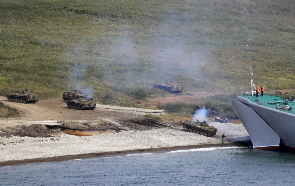 """A Russian navy landing vessel unloads an armored vehicle during Russian military maneuvers Vostok 2018 on the training ground """"Klerk,"""" about 50 kilome"""