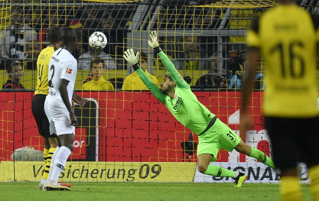 Frankfurt's keeper Kevin Trapp receives the third goal by Dortmund's Paco Alcacer during the German Bundesliga soccer match between Borussia Dortmund ...