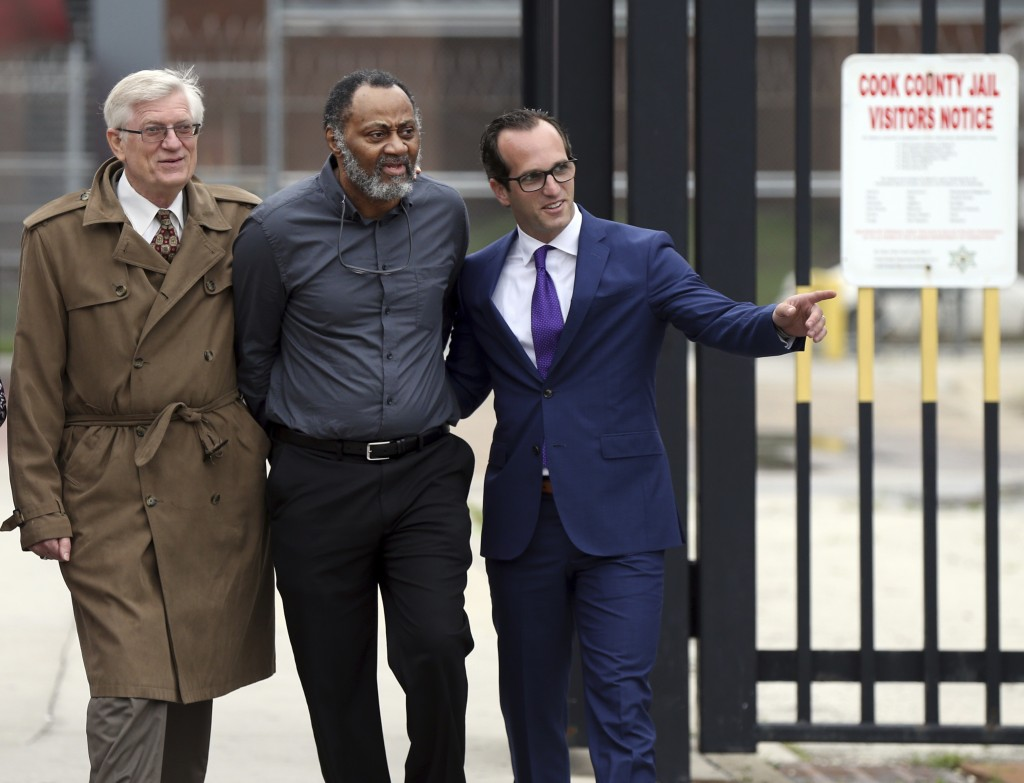 FILE - In this Friday, June 22, 2018 file photo, Jackie Wilson, flanked by his attorneys G. Flint Taylor, left, and Elliot Slosar, leaves the Cook Cou
