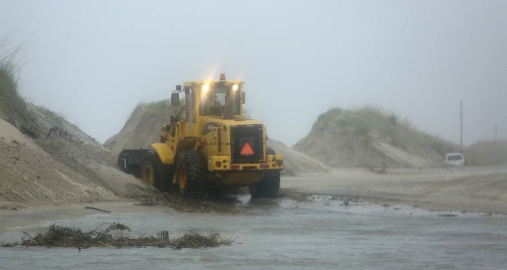 Breaches in the dune line on Hwy 12 between Frisco and Hatteras Village, N.C., created by Hurricane Florence's storm surge, are filled in. Friday, Sep