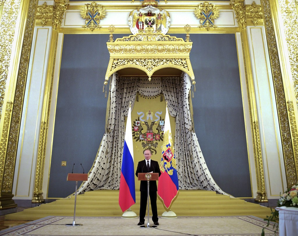 File - In this file photo taken on Wednesday, June 28, 2017, Russian President Vladimir Putin addresses graduates of the military and police academies...
