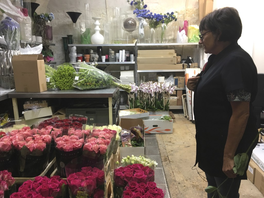 In this Thursday, Sept. 13, 2018 photo,  Marianne Fuseau, head florist, stands in the flower atelier at the Elysee presidential palace in Paris. The F
