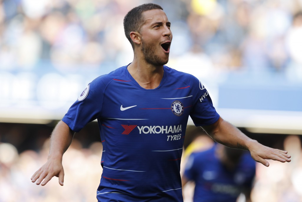 Chelsea's Eden Hazard celebrates scoring his side's first goal during their English Premier League soccer match between Chelsea and Cardiff City at St